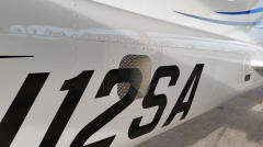 Cessna 172SP with vent for air-conditioning on the side of the fuselage.